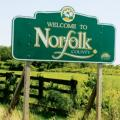 Norfolk County sign on a road.